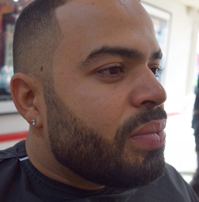 Beard blended into hair earring beard style North Bristol barbers